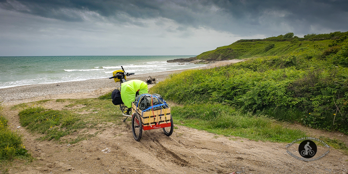 Bicycle and trailer on Ennereilly Beach County Wicklow - panorama