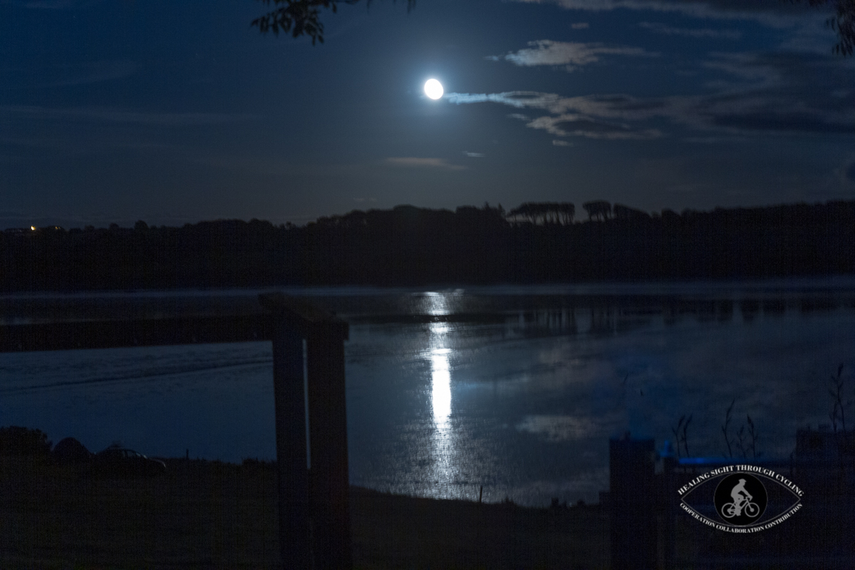 Rising moon over the water