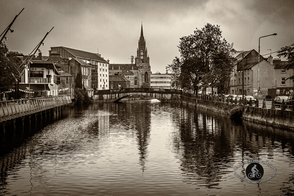 Saint Fin Barres Cathedral over the River Lee - Cork City - Cork County - vignette - Sepia