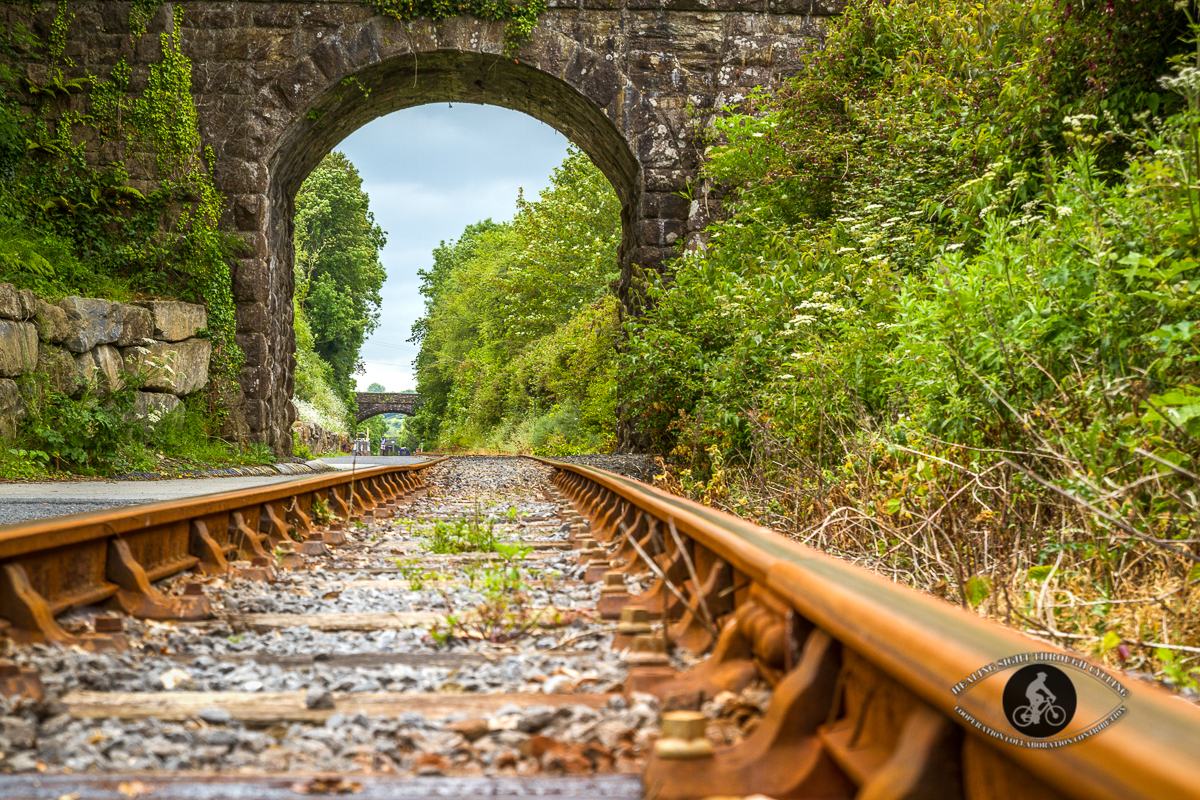 Stone arch over train tracks and Waterford Greenway - 2
