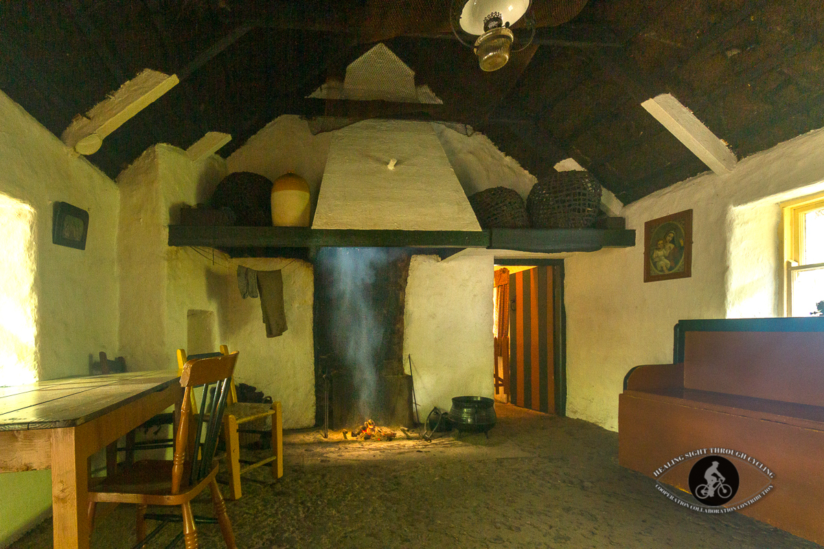 Inside old building in Bunratty Castle Village with turf fire burning