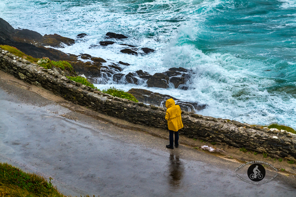 Man on road with waves in the Wild Atlantic Way near Dingle
