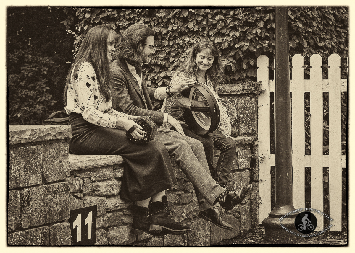 Musicians in Bunratty Village - with spectator - sepia