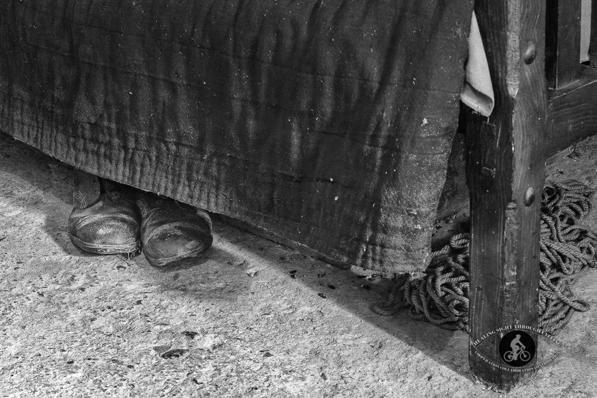 Old shoes under bed inside old building in Bunratty Castle Village - BW