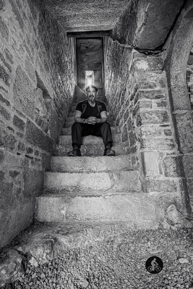 Sitting on stairs to nowhere in the Adare Augustinian Friary - County Limerick - BW