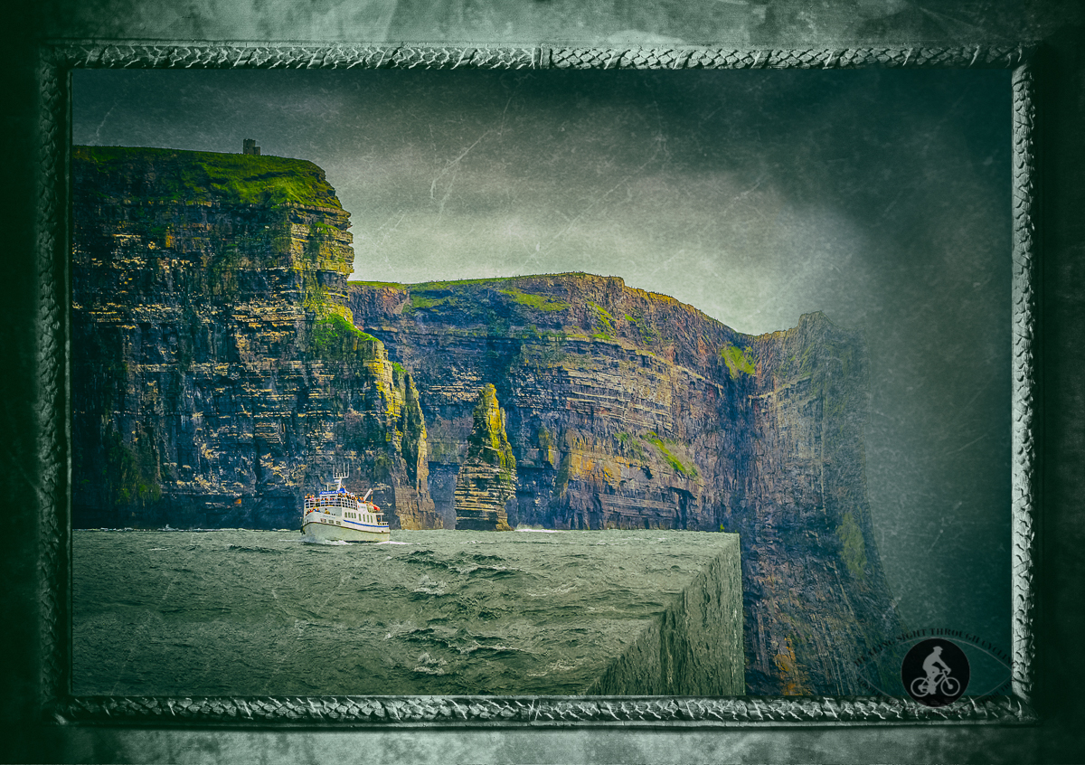 Bordered and faded print - Diagonal ocean - Queen of Aran boat in the Atlantic Ocean under the Cliffs of Moher, O'Briens Tower and Branaunmore sea stack in County Clare - Ireland