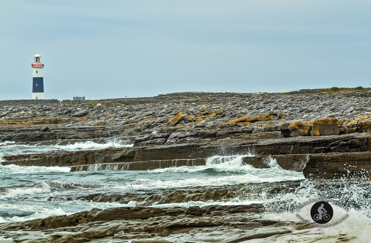 Rocks and waves in front of Inisheer Lighthouse