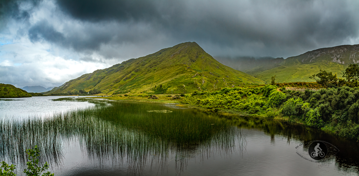Pollacapall lough and Twelve Bens Mountain Range - Dark clouds - County Galway - Panorama