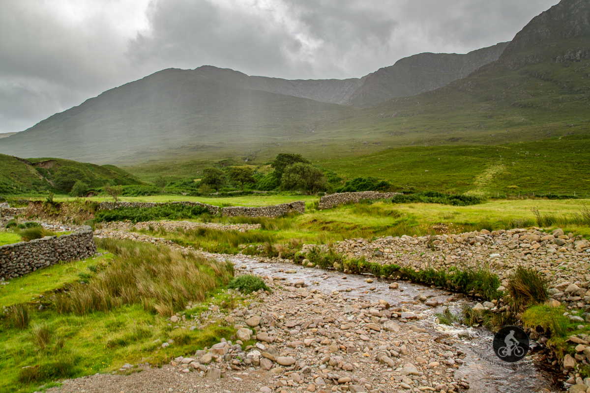 River leading to River Erriff - N59 - with rain on Partry Mountains in the background - County Mayo