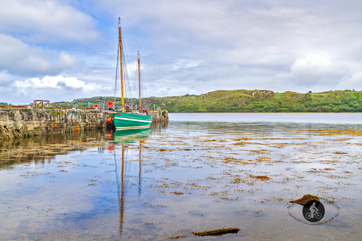 Sailboat and harbour at the Letterfrack Pier - County Galway - some blue sky - side view
