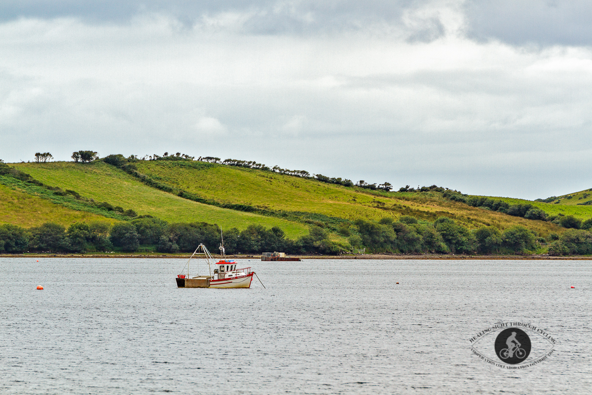 Boat in the harbour seen from Carrickahowley Castle - County Mayo