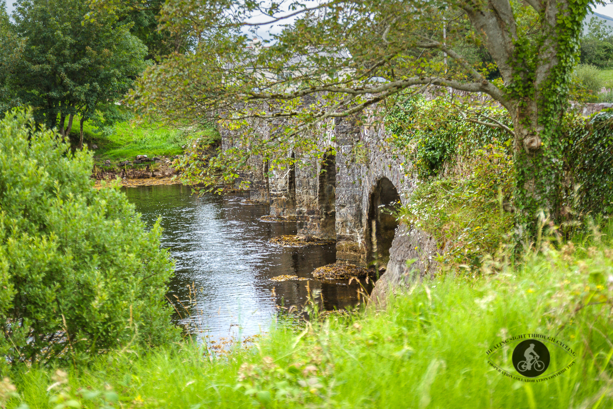 Sharp side view of 7 arch bridge over Lough Feeagh - County Mayo