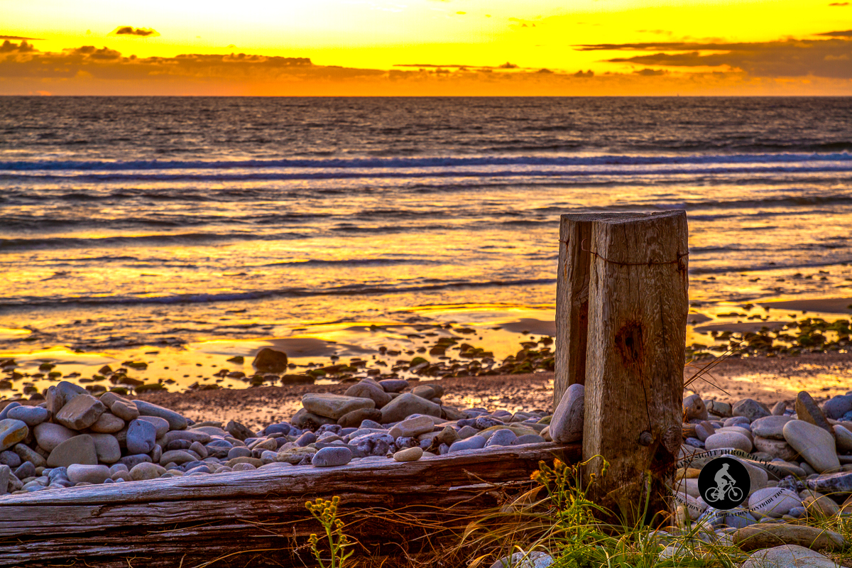 Sun setting on beach of Strandhill Caravan & Camping Park - County Sligo - wooden wall - back OOF